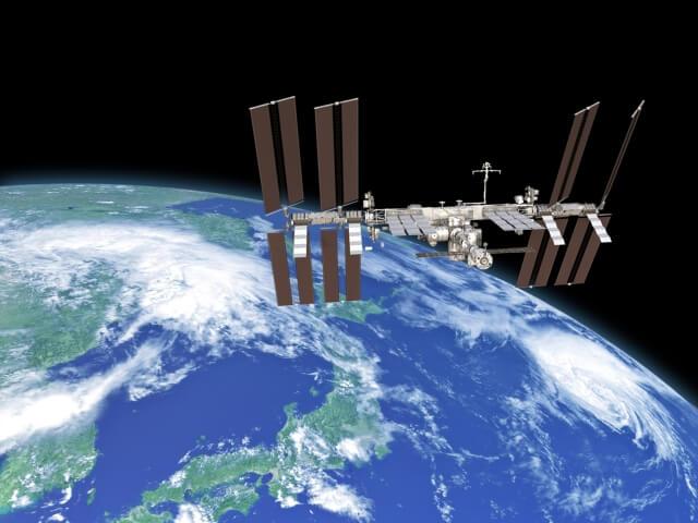地球上を周回する国際宇宙ステーション f